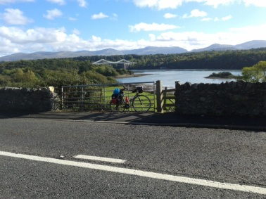 On sunny Anglesey, looking back across Menai Bridge towards Snowdonia